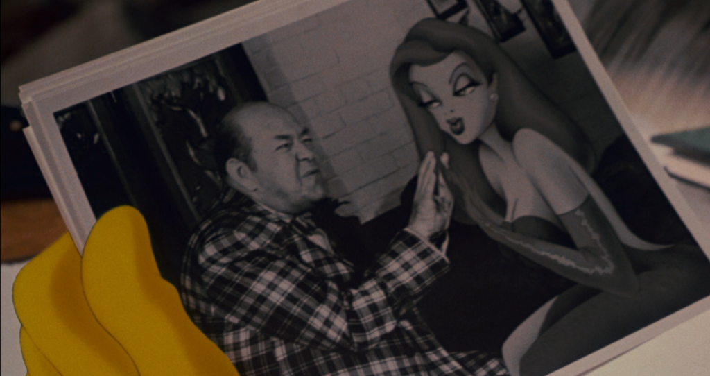 Jessica Rabbit doing a Children's hand clap game with a man who isn't her significant other.